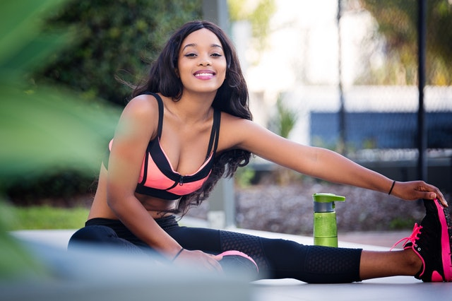 woman posing in exercise gear